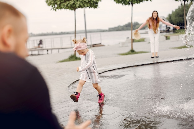 Family with daughter playing in a park