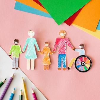 Famiglia con persona disabile in vista dall'alto di carta ritaglio