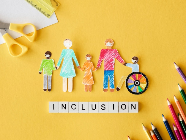 Family with disables person in cutout paper