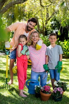 Family with gardening equipment in yard