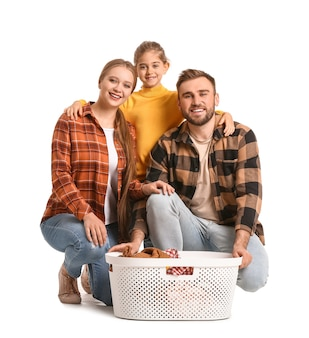 Family with laundry on white surface