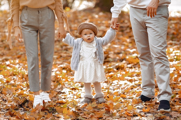 Family with little daughter in a autumn park