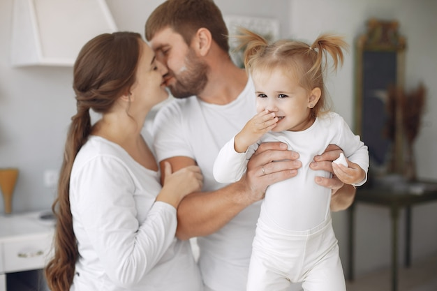 Family with little daughter having fun at home
