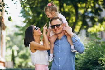 Family with little daughter together in park