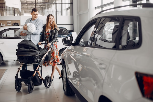 Family with little son in a car salon
