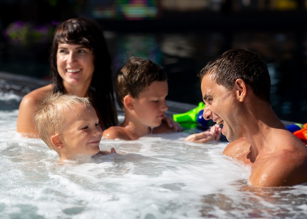 Family with two kids enjoying their day at the swimming pool