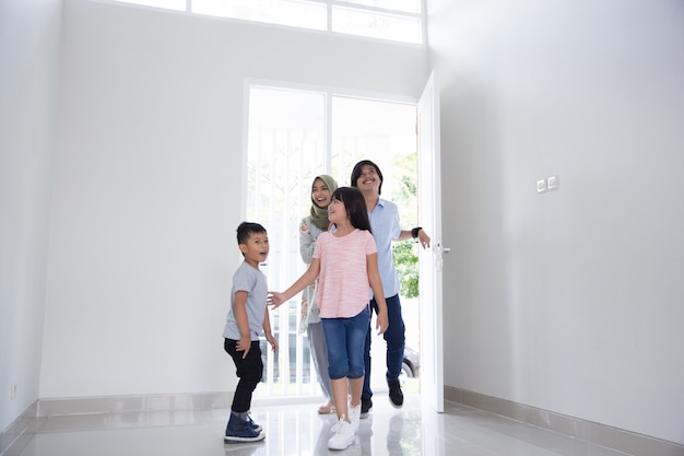 Family with two kids entering their new house