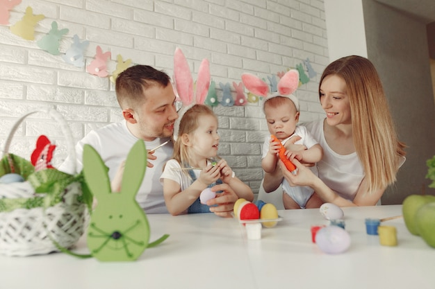 Family with two kids in a kitchen preparing to easter