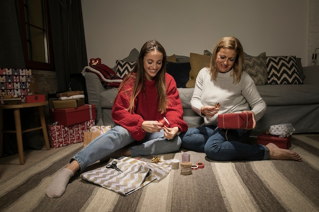 Family wrapping up presents for christmas
