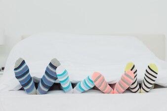 Familys feet in stripey socks