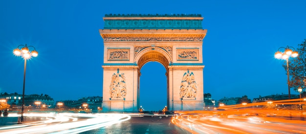The famous arc de triomphe by night, paris france