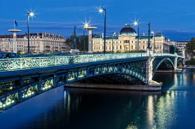 Famous bridge and university in lyon by night
