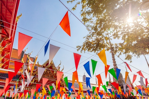 The famous buddhist temple of reclining buddha in bangkok thailand, decorated with colorful flags