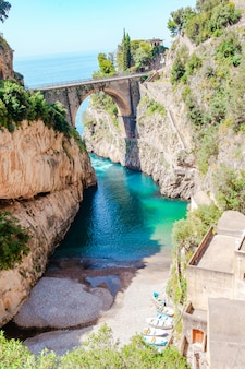 Famous fiordo di furore beach seen from bridge.