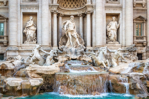 The famous fountain of the trevi in rome, executed in the baroque style.