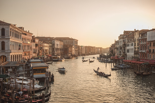 Famous grand canale from rialto bridge at golden hour, venice, italy