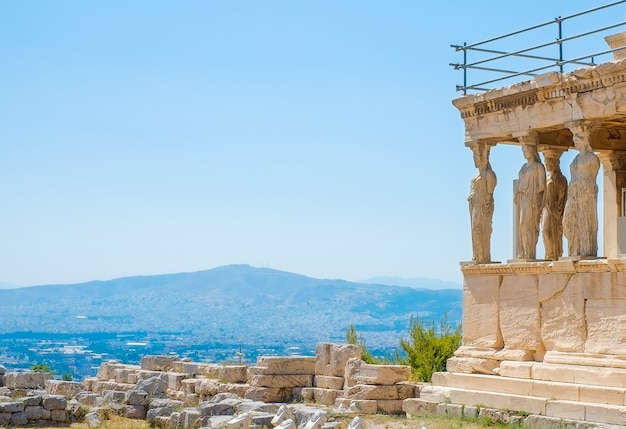 Famous greek athena nike temple against clear blue sky, acropolis of athens in greece