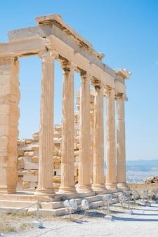 Famous greek temple pillars against clear blue sky in greece