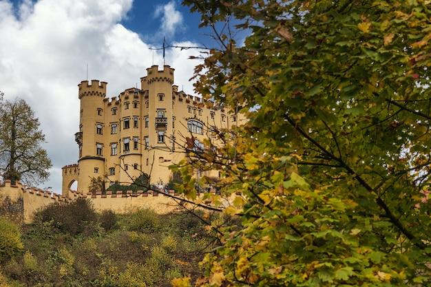 Famous hohenschwangau bavarian castle and cloudy sky in early autumn season