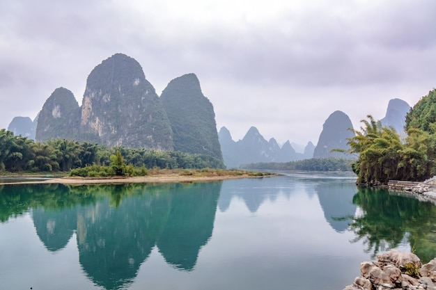 Famous landscape of rocks and water by li river in guangxi region, guilin, china