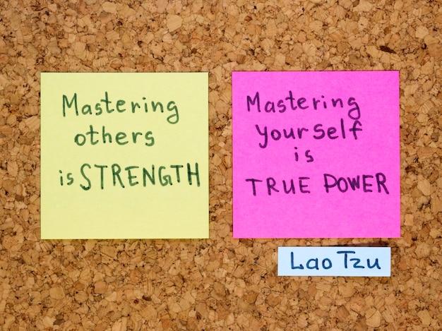 Famous lao tzu quote interpretation with sticker notes on cork board