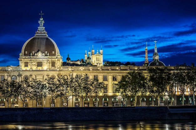 Famous lyon city after sunset with rhone river