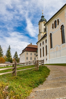 Famous pilgrimage church wieskirche and green lawn view in bavaria, germany