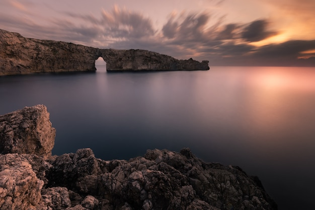 Famous pont d'en gil at the west coast of menorca, balearic islands, spain.