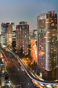 Famous shiodome area during evening time in minato, tokyo, japan