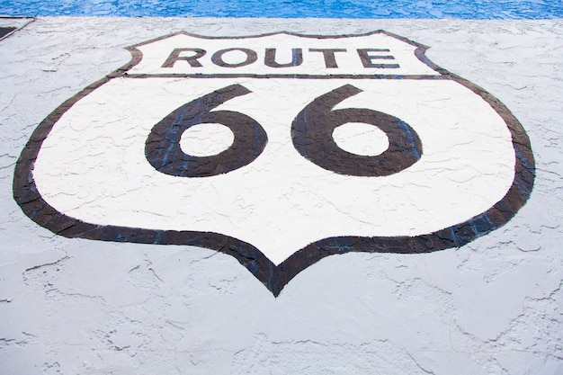 Famous streetsight of route 66 painted on a wall in flagstaff
