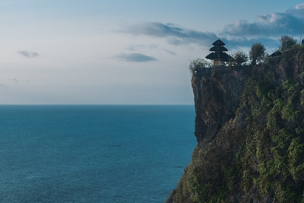 Famous uluwatu temple in bali, indonesia. sunset
