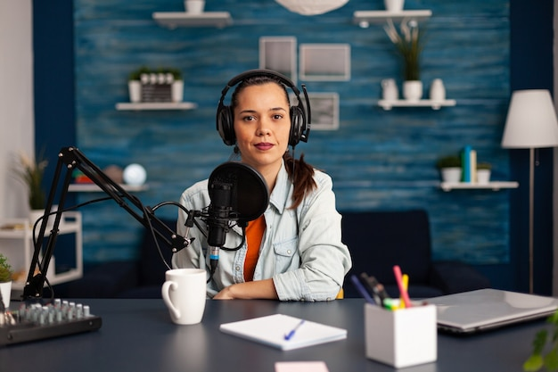 Famous video blogger streaming from home studio podcast using professional recording equipment. social media content creator making fashion content for her channel where is sharing advice for beauty c