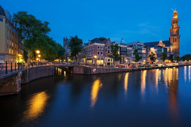 Famous view of amsterdam canal by night. netherlands