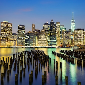 Famous view of new york city manhattan downtown skyline at dusk, usa.