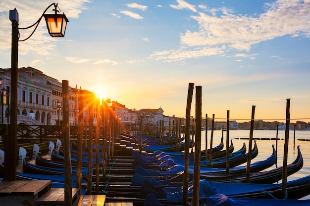 Famous view of venice with gondolas at sunrise