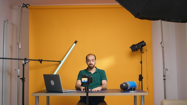 Famous vlogger recording video for subscribers looking at the camera in studio. social media podcast and review, blogging vlogging, digital internet web era, influencer recording for online distributi