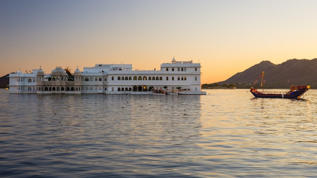 The famous white palace on lake pichola at sunset.