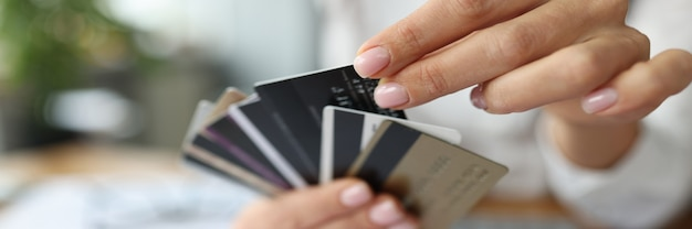 Fan of plastic credit cards is in womans hand