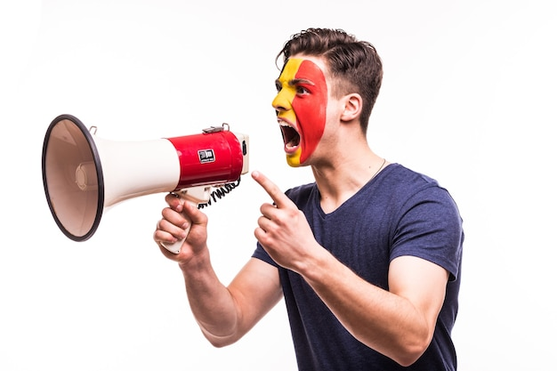 Fan support of belgium national team with painted face shout and scream on megaphone isolated on white background