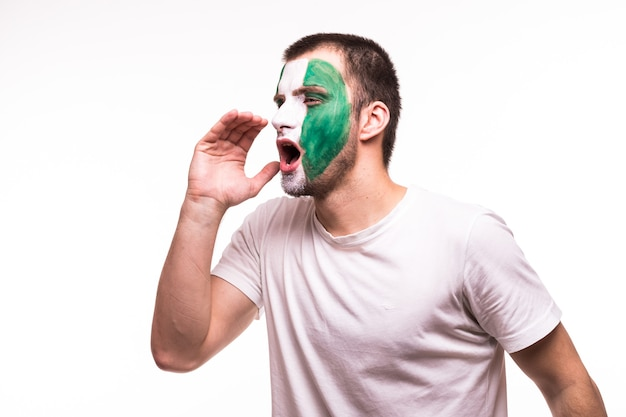 Fan support of nigeria national team with painted face shout solated on white background