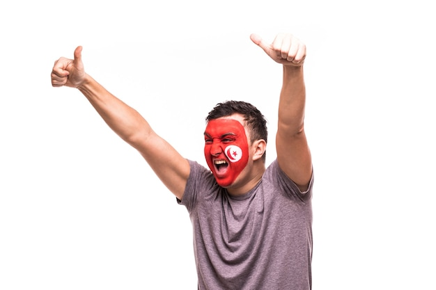 Fan support of tunisia national team with painted face shout and scream isolated on white background
