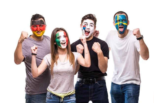 Болельщики национальных сборных с нарисованным лицом флага германии, мексики, республики корея, швеции.