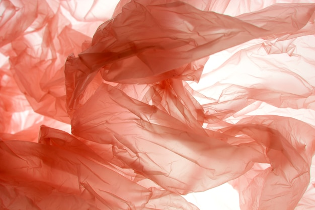 幻想的な抽象的なオレンジ色の布の背景。グラデーションの背景の色。柔らかい色の背景。カラフルな抽象的なハーフトーンの背景。モダンな流行色