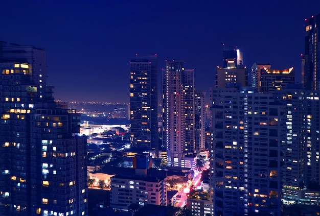 Fantastic aerial view of downtown bangkok with skyscrapers at night in deep blue color