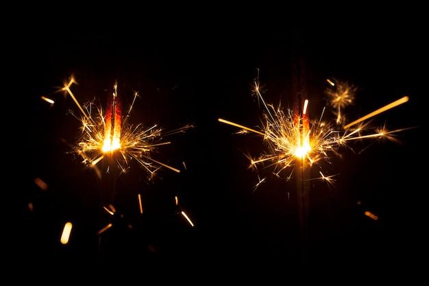 Fantastic burning sparklers on dark background