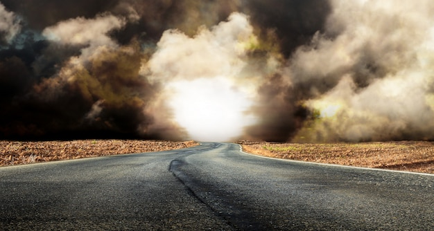 Fantastic desert road with clouds