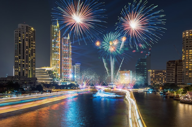 Fantastic multicolor firework exploding over the bangkok cityscape river side for celebrat