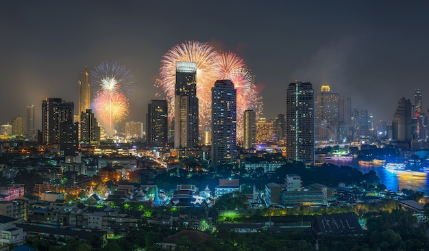 Fantastic multicolor firework exploding over the panorama of bangkok cityscape