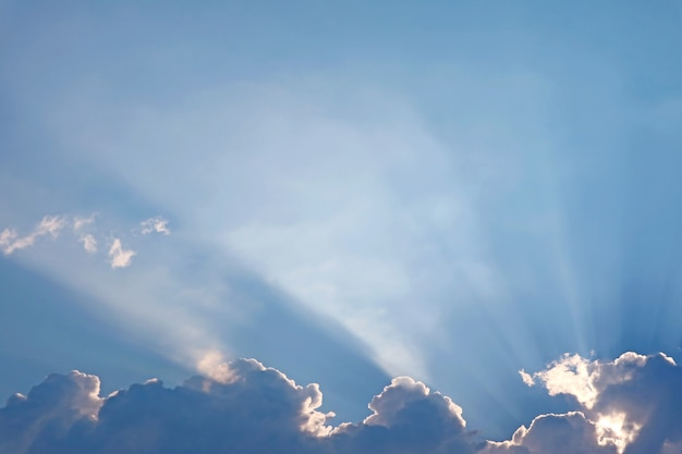 Fantastic sunbeam shining through the fluffy clouds