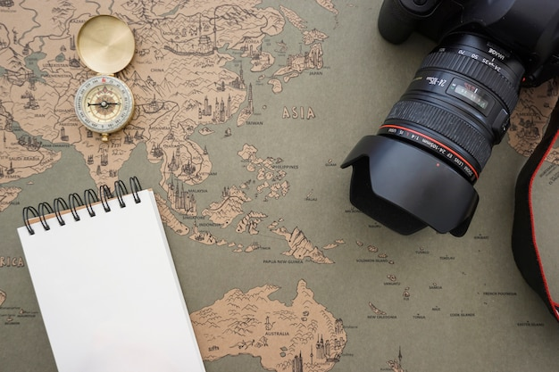 Fantastic travel background with camera and notebook for messages
